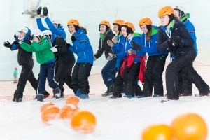 Ready, Steady, Roll! Kids carve up the snow with pumpkins